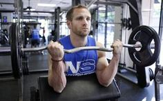 Ryan Latham working out at Trophy Fitness Club Uptown