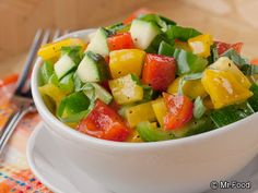Summer Vegetable Salsa - Includes bell peppers and zucchini! We love putting this on top of a simple grilled chicken or fish.