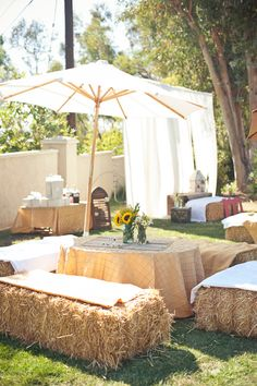 Hay bales for outdoor seating, great for a fall party.  Awesome idea and probably a lot cheaper than renting chairs...and you can use it as compost / mulch in the garden.