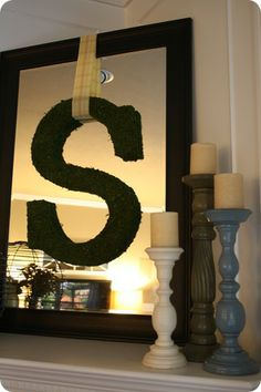 I love this look of a giant letter draped over a mirror. Turns the mirror into a piece of art! Instructions here: http://thriftydecorchick.blogspot.com/2011/03/mossy-vignette.html #mirror #art #DIY #crafts