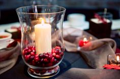 Cranberries + a candle in a glass vase. So beautiful for a red and fall themed wedding! ::Deanna + Bob's radiantly red fall wedding at the Cathedral of Christ the King and Ippolito's in Atlanta, Georgia:: #centerpiece #decorideas #redtheme