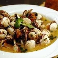 These clams are steamed in wine, butter, and spices. when the clams are gone, dip italian bread in the broth.