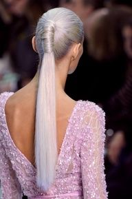 Wrap your hair around your pony to create a sleek effect.
