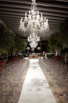 Crystal chandeliers and ghost chairs