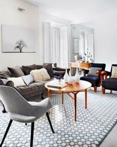 Madrid living room. Modern. Warm and inviting. Good small living room layout with plenty of seating.