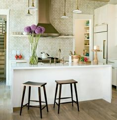 Wake up your kitchen walls with elegant ceramic tiles! By: Angie Hranowsky (Cultivate.com)
