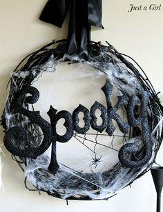 Spooky Halloween Wreath... Get vine wreath, spray paint black!