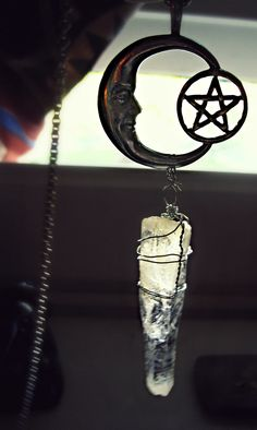 Moon and pentacle pendant with crystal quartz