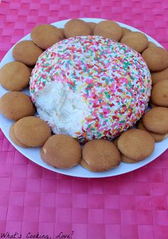 Funfetti Cheeseball 1 package (8 ounces) cream cheese, softened 1/2 cup butter, softened 1 1/2 cups funfetti cake mix, dry 3 tablespoons sugar 1/2 cup powdered sugar 1/2 cup rainbow jimmies (sprinkles) Vanilla Wafers, graham crackers, fruit, or other cookies for dipping