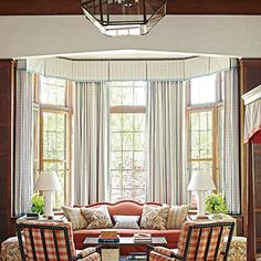 """Humanized the Scale     """"When you have a large space, you have to go big,"""" says interior designer Lindsey Coral Harper. The large repeat on the plaid carpet feels appropriate for the size of the room, and an overscale lantern from Circa Lighting brings down the 30-foot ceiling."""