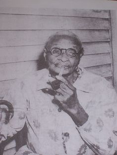 "SUSAN CRUMBAUGH, FORMER SLAVE in Lyon County, Kentucky at Age 103 years, (photograph was taken in 1957 when she was 103 years old).  Born a Slave in Kentucky in 1854.  In 1957,  ""The Paducah Sun,"" ran a feature story on her life."