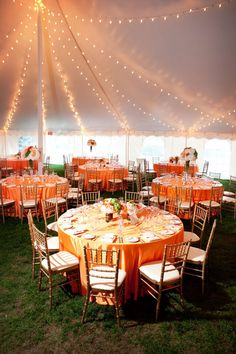 tent wedding, orang, reception lighting