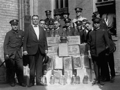 Police display confiscated moonshine during prohibition. Washington, DC. 1922.