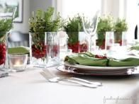 Finding Home  offers this beautiful, and easy way to create a holiday centerpiece, using glass  containers, fresh cranberries and sprigs of pine and boxwood.