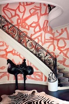 Street Graffiti as Interior Art: I love everything about that Picture, the staircase (it even looks like a cool spiral staircase), the graffiti on the walls, the carpet and the animal print on it, everything!!!