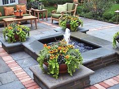 Cool Ponds, Pools and Fountains for the Backyard: A simple four-foot pond, with a center fountain forms the beautiful centerpiece of a bluestone-and-brick patio. From DIYnetwork.com