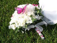 white beautiful hydrageas and hot pink butterflies