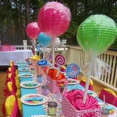 DIY Giant Lollipop Party Centerpiece Use the PVC pipe idea for height, maybe the paper lanterns for color, put in a sand bucket with maybe some shells, flip flops, leis, etc coming out??