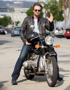 Gerard Butler on His Motorcycle Wearing a Leather Jacket, Jeans, and Helmet