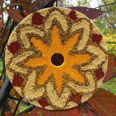 I'm totally enchanted by this Mesmerizing Mandala...can you guess what it's made of? | AllFreeKidsCrafts.com
