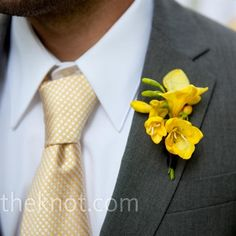 To brighten up his charcoal gray suit, Doug wore a yellow freesia boutonniere.
