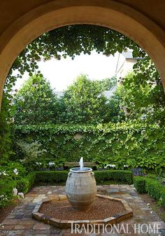 "darling courtyard, like the ""trellis"" wall - two types of vining plants used, jasmine on the trellis and creeping fig in the centers.  Picturesque Courtyard Garden 
