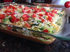Layered Bean Dip - Great Food and Lifestyle.  Perfect for football parties, a healthy lunch, or any other occasion!  For more healthy, easy recipes, follow me on Pinterest and subscribe to www.GreatFoodLifestyle.com.
