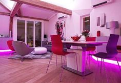 Living room design with neon magenta lighting accents