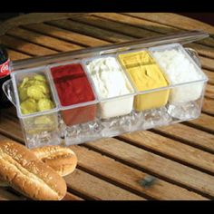 CONDIMENTS ON ICE.  Take your summer party outside and keep everything cold and fresh. This all in one serving dish features 5 individual trays to hold condiments, snacks, dips  appetizers, plus a lid to keep out bugs and dirt. Simply fill the main tray with ice to keep everything cold.