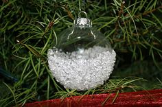 Clear ornament ball dipped in glue then dipped in epsom salts! looks like snow!!