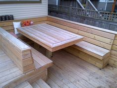 The design for this deck was inspired by HIghline Park in New York. The homeowner had recently been there on a trip and really liked the style of the site furniture in the park. The homeowner did not want any deck furniture....any seats or tables had to be built in. There are two long built-in seats with backrests, a built-in ottoman and a built-in dining table surrounded with seating. There are also built-in planters on the deck for annuals or small perennials.