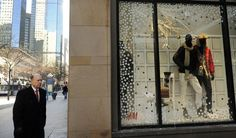 Winter menswear in the windows of the new H&M store on the 16th Street Mall on Wednesday, December 7, 2011. (Cyrus McCrimmon, The Denver Post)