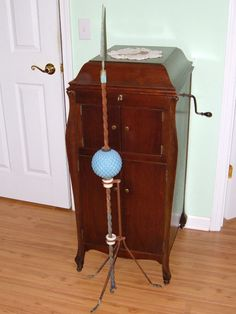 Antique lightning rod with blue quilted glass ball.