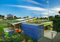 Recycled shipping containers with rooftop garden and solar panels