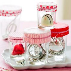 If your gift is small enough, place it in a votive holder, top with a paper muffin liner, and tie with a colorful string or ribbon. More ideas: http://www.bhg.com/holidays/valentines-day/cards/make-your-own-valentines-day-gifts/