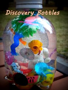 infant toddler discovery bottles, homemade baby toys, homemade baby gifts, upcycle plastic bottle