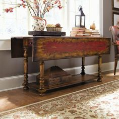 Seven Seas Drop-Leaf Console Table by Hooker Furniture. $1208.00. One drawer on each end. What to do when additional dining guests drop in at the last moment?. For matching furniture, please see Primitive Chest 978-85-122. This beautiful drop-leaf console table is an ideal. Dimensions in the down position: 66 x 24 1/4 - 31H. 978-50-001 Features: -Console table.-Handpainted.-Can be used as a space-saving dining table, a desk or as a console.-Open position drop-leaves acco...
