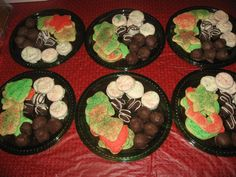 Christmas platters i made for the guys that my husband works with.  Had sugar cookes some w/ frosting some w/ just sprinkles, oreo balls, peanut butter balls, and peanut butter sandwich ritz crackers dipped in white almond bark, also made mini loaves of pumpkin bread.