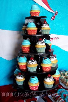 Cat in the Hat #DrSuess theme cupcake tower from http://www.CupcakeWhimsy.com