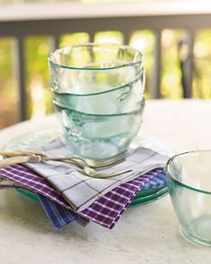 Make lovely cloth napkins out of your worn oxford shirts -- not only will they look great on your dinner table, but they'll also reduce the need for paper products.