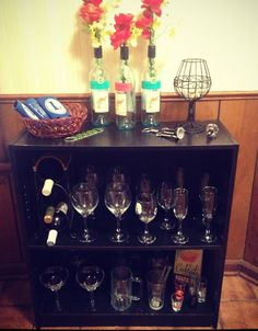 Turned an old bookshelf into a bar for my dining room! Used old wine bottles for vases.