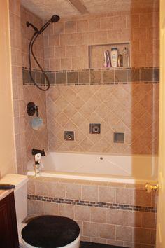 Beautiful bathroom tile!  Love around the tub!
