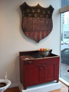 Beautiful 1850s red dry sink and patriotic shield.