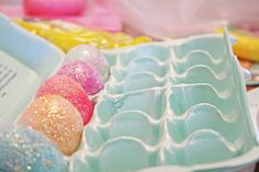 Easy Glitter Easter Eggs!  apply glue with paint brush and roll in bowl of glitter.