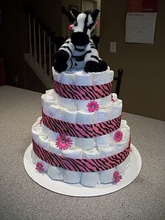 Zebra and pink baby shower ideas!  Great diaper cake, favors and decorating ideas!