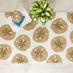 Sand Coin Indoor / Outdoor Rug | The Company Store. You can almost smell the salt air from the modern sand dollar design on this indoor / outdoor rug design