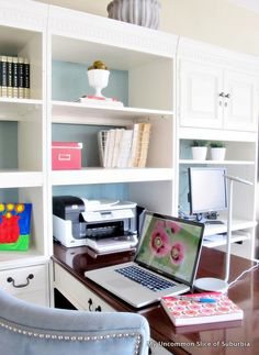 Loft transformation into office space - love the shelves!  I want an office like this one day!