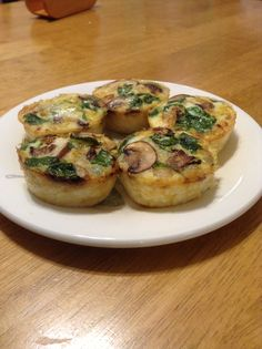 "Egg white ""muffins"" - sautéed onions, baby portobellos, baby spinach in butter. Poured 1/3 cup egg whites into Pam sprayed muffin tins, added veggie mix, baked on 350 for 25 min. Added water to empty tins."