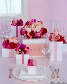 clever: stems sit in hidden vases; favor boxes filled w/ candy = place cards
