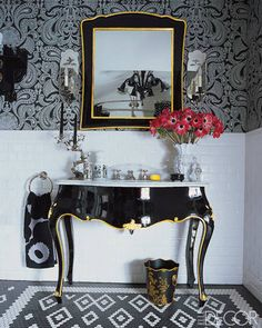 At Home with Anna Sui ... The bathroom's Italian mirror and sink were lacquered and outlined in gold leaf by E. Polarolo & Sons, the wall covering is by Cole & Son, and the sconces are by Vaughan.